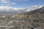 pic of mustang  - Landscape of Muktinath village in lower Mustang District Nepal. This photo was shot in early morning. Area was cover by snow. - JPG
