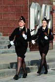foto of kalashnikov  - Two women cadets of the Vladivostok State Medical University in uniform marching with Kalashnikovs - JPG