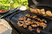 image of chicken wings  - Teriyaki chicken wings with garlic bread and herbs - JPG