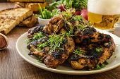 picture of chive  - Grilled teriyaki chicken wings with chive and microgreens on top garlic toast with fresh herbs and czech beer - JPG