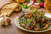 pic of chive  - Grilled teriyaki chicken wings with chive and microgreens on top garlic toast with fresh herbs and czech beer - JPG