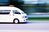 picture of ambulance  - blurry Ambulance high speed in motion driving on the road - JPG