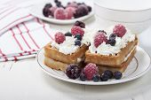 stock photo of berries  - Soft waffles with protein cream berry jam whipped cream and berries - JPG