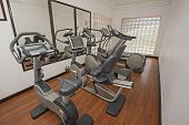 image of health center  - Exercise machines in luxury private health center gym room - JPG
