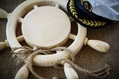 picture of steers  - wood steering wheel with a rope on the table - JPG