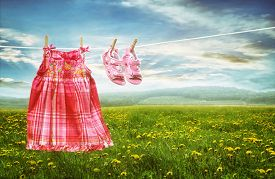 picture of clotheslines  - Dress and sandals on clothesline in summer fields of dandelions - JPG