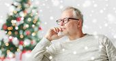 old age, holidays, problem and people concept - senior man in glasses thinking at home over christma poster