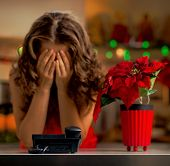 Frustrated Woman Waiting For A Phone Call In Christmas Kitchen poster