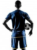 one caucasian soccer player man standing Rear View in silhouette isolated on white background poster