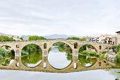 stock photo of gare  - romanesque bridge over river Arga - JPG
