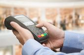 Hand Using Credit Card Payment Machine poster