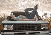 Beautiful Girl On The Car. Beautiful Girl On The Hood Of A Jeep. Girl With A Car In A Field With Cor poster