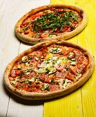 Pizza With Pepperoni, Mushrooms And Egg On Yellow Wooden Background poster