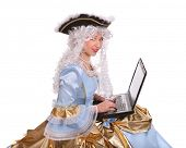 foto of marquise  - Woman in ancient dress of marquise with laptop - JPG