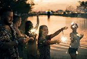 People Enjoying Sparkler in Festival Event poster