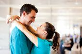 stock photo of bye  - loving young couple say good bye at airport - JPG