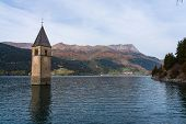 The Famous Bell Tower In The Lake Of Reschen - Lago Di Resia In South Tyrol, Italy. During Ww2 A Dam poster