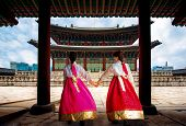 Korean Lady In Hanbok Or Korea Gress And Walk In An Ancient Town And Gyeongbokgung Palace In Seoul,  poster