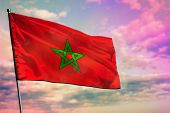 Fluttering Morocco Flag On Colorful Cloudy Sky Background. Morocco Prospering Concept. poster