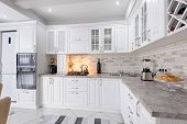 interior of modern white wooden kitchen in luxury home poster