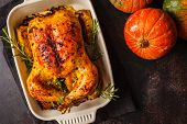 Thanksgiving Baked Chicken With Spices And Herbs In Glass Dish. Thanksgiving Concept. poster