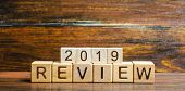 Wooden Blocks With The Word Review 2019. Business Concept. Feedback, Progress. New Trends And Prospe poster
