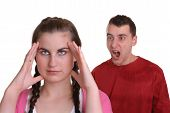 foto of conflict couple  - man shouting at young lady who has a headache  - JPG