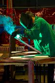stock photo of tig  - The process of welding metal in the manufacturing industry - JPG