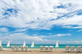 Find Great Values In Glitzy South Beach. Miami South Beach. Sunbeds And Umbrellas On Sandy Beach. Fl poster