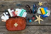 Summer Womens Beach Accessories For Your Sea Holiday And First Aid Kit On Old Wooden Background. Co poster