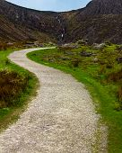 Path Winding Through A Boulder Strewn Valley Leading To Mahon Falls In Waterford County, Ireland poster