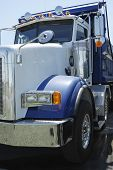 image of dump_truck  - Close up of a white and blue dump truck - JPG