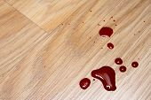 stock photo of gash  - Drops of blood on laminate floor texture - JPG