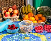 image of tangelo  - A selection of healthy snacks including fruit berries and nuts on a colorful cloth - JPG