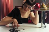 image of table manners  - attractive young beautiful girl sitting at the table - JPG