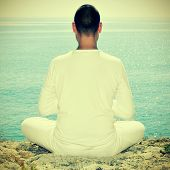 picture of padmasana  - someone meditating in front of the sea - JPG