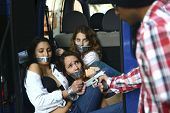 stock photo of kidnapped  - Men kidnapping gagged and tied up women - JPG