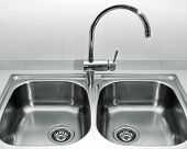 foto of valves  - a double bowl stainless steel kitchen sink on a white granite worktop - JPG