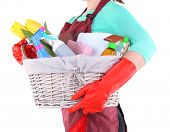 stock photo of spring-cleaning  - Housewife holding basket with cleaning equipment - JPG