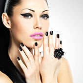 Face Of The Beautiful Woman With Black Nails And Pink Lips