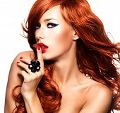 foto of long nails  - Beautiful sensual woman with long red hairs and red nails  - JPG