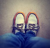 stock photo of flat-foot  - a shot of yellow and white boat or deck shoes done with a retro vintage instagram filter - JPG
