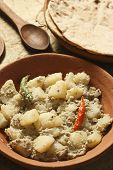 stock photo of bengali  - Aloo Posto is a delicious Bengali side dish generally eaten as a dry accompaniment to a meal of rice and curries - JPG