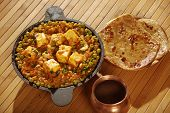 foto of paneer  - Mattar Paneer is a north Indian dish consisting of Paneerthe Indian cottage cheese and peas in a slightly sweet spicy sauce - JPG