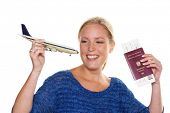 a young woman with the model of an airplane and their passport is looking forward to your next vacat
