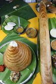 stock photo of ghee  - Ghee Roast Dosa is prepared by adding liberal doses of butter - JPG