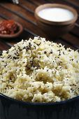 stock photo of ghee  - Moong dal khichdi made of rice and dal cooked together with peppercorns and flavored with ghee - JPG