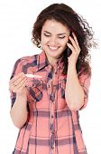 stock photo of teen pregnancy  - Beautiful girl with pregnancy test talking on cell phone on white background - JPG