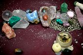 stock photo of pagan  - Varied collection of quartz crystals polished stones crystal ball and prayer candle on pagan alter - JPG