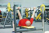 pic of triceps brachii  - athlete man at arm muscles exercises with training weight in fitness club gym - JPG
